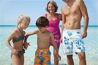 Children holding hands at the beach Stock Photo - Premium Royalty-Freenull, Code: 632-05759952