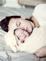 Mother and new born baby sleeping in bed Stock Photo - Premium Royalty-Freenull, Code: 632-05759967