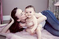 Mother kissing baby girl, portrait Stock Photo - Premium Royalty-Freenull, Code: 632-05759986