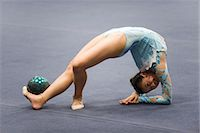 feet gymnast - Female gymnast performing floor routine with ball Stock Photo - Premium Royalty-Freenull, Code: 632-05760121
