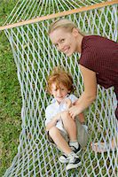 Mother tickling son in hammock Stock Photo - Premium Royalty-Freenull, Code: 632-05760370