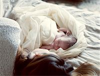 New born baby and mother resting in bed Stock Photo - Premium Royalty-Freenull, Code: 632-05760391