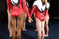 preteen girls gymnastics - Group of female gymnasts holding hands in circle Stock Photo - Premium Royalty-Freenull, Code: 632-05760411