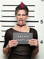 Studio mugshot of mature woman sticking out tongue Stock Photo - Premium Royalty-Freenull, Code: 640-05760901