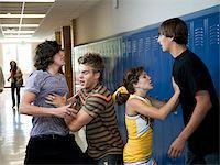 student fighting - USA, Utah, Spanish Fork, Four school children (16-17) fighting in school corridor Stock Photo - Premium Royalty-Freenull, Code: 640-05761063