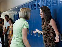 student fighting - USA, Utah, Spanish Fork, Two girls (16-17) arguing in school corridor Stock Photo - Premium Royalty-Freenull, Code: 640-05761078