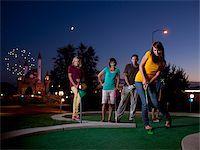 USA, Utah, Orem, Parents and kids (10-17) playing golf Stock Photo - Premium Royalty-Freenull, Code: 640-05761137