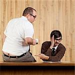Businessman ignoring colleague at desk in office Stock Photo - Premium Royalty-Free, Artist: Didier Dorval, Code: 640-05761202