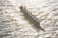 sport rowing teamwork - People oaring canoe during competition Stock Photo - Premium Royalty-Freenull, Code: 618-05761594