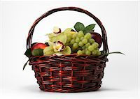 A basket of fruit and flowers Stock Photo - Premium Royalty-Freenull, Code: 618-05761941