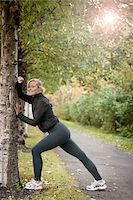 Jogger Stretching Against Tree Stock Photo - Premium Rights-Managednull, Code: 700-05762107