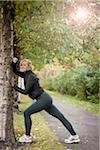 Jogger Stretching Against Tree Stock Photo - Premium Rights-Managed, Artist: Atli Mar Hafsteinsson, Code: 700-05762107