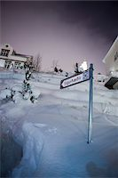 small town snow - Directional Sign Pointing Towards Sigurhaedir, Akureyri, Iceland Stock Photo - Premium Rights-Managednull, Code: 700-05762109
