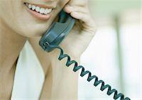 phone cord - Woman using landline phone Stock Photo - Premium Royalty-Freenull, Code: 695-05762746