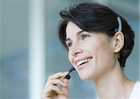 switchboard operator - Woman wearing headset Stock Photo - Premium Royalty-Freenull, Code: 695-05762792
