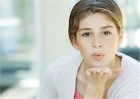 preteen kissing - Preteen girl blowing kiss Stock Photo - Premium Royalty-Freenull, Code: 695-05763350