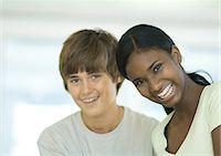 preteen girl boyfriends - Preteen boy and girl smiling Stock Photo - Premium Royalty-Freenull, Code: 695-05763351