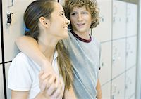 Teen couple leaning against school lockers Stock Photo - Premium Royalty-Freenull, Code: 695-05763374
