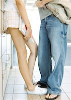 preteen thong - Teen couple leaning against school lockers, waist down Stock Photo - Premium Royalty-Freenull, Code: 695-05763376