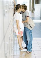 Teen couple leaning against school lockers Stock Photo - Premium Royalty-Freenull, Code: 695-05763377