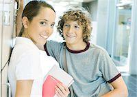 preteen girl boyfriends - Teen couple leaning against school lockers Stock Photo - Premium Royalty-Freenull, Code: 695-05763378