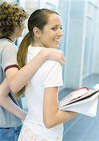 preteen girl boyfriends - Teen couple walking in school hallway Stock Photo - Premium Royalty-Freenull, Code: 695-05763380