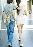 preteen girl boyfriends - Teen couple walking in school hallway, rear view Stock Photo - Premium Royalty-Freenull, Code: 695-05763381