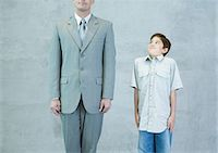 Boy imitating businessman Stock Photo - Premium Royalty-Freenull, Code: 695-05763502