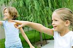 Girls pointing and looking out of frame Stock Photo - Premium Royalty-Free, Artist: AWL Images, Code: 695-05763519