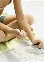 Girl playing in sand, close-up of hands Stock Photo - Premium Royalty-Freenull, Code: 695-05763567