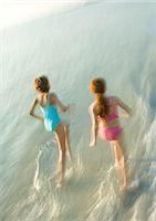 Two girls running in surf Stock Photo - Premium Royalty-Freenull, Code: 695-05763595