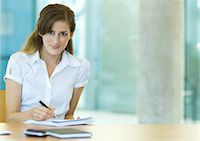 secretary desk - Female office worker sitting at desk, working Stock Photo - Premium Royalty-Freenull, Code: 695-05763945