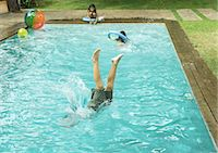 Boy diving into pool Stock Photo - Premium Royalty-Free, Artist: Mick Ritzel, Code: 695-05764249