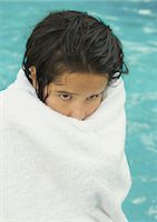 Girl wrapped in towel, pool in background Stock Photo - Premium Royalty-Freenull, Code: 695-05764269