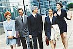 Group of business executives walking in business park Stock Photo - Premium Royalty-Freenull, Code: 695-05764572