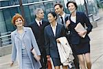 Group of business executives walking in business park Stock Photo - Premium Royalty-Freenull, Code: 695-05764573