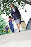Businesswoman walking with son Stock Photo - Premium Royalty-Freenull, Code: 695-05764600