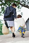 Businesswoman walking with son Stock Photo - Premium Royalty-Freenull, Code: 695-05764601