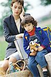 Businesswoman sitting with son, holding head Stock Photo - Premium Royalty-Freenull, Code: 695-05764603