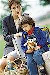 Businesswoman sitting with son, holding head Stock Photo - Premium Royalty-Freenull, Code: 695-05764604