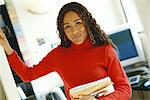 Young woman in office, smiling at camera Stock Photo - Premium Royalty-Free, Artist: Siephoto, Code: 695-05764785