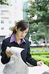 Businesswoman reading newspaper Stock Photo - Premium Royalty-Free, Artist: Robert Harding Images, Code: 695-05765049