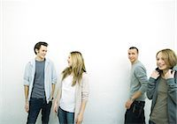 Young male and female friends, white background Stock Photo - Premium Royalty-Freenull, Code: 695-05765115