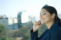 south american woman - Woman using cell phone, side view Stock Photo - Premium Royalty-Freenull, Code: 695-05765185