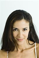 Woman smiling at camera, portrait Stock Photo - Premium Royalty-Freenull, Code: 695-05765823