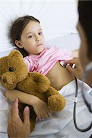 Doctor listening to child's chest with stethoscope Stock Photo - Premium Royalty-Freenull, Code: 695-05765951