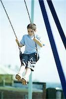 Child on swing Stock Photo - Premium Royalty-Freenull, Code: 695-05765996