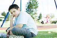 Child sitting on playground Stock Photo - Premium Royalty-Freenull, Code: 695-05765998