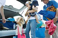 Family unloading trunk of car Stock Photo - Premium Royalty-Freenull, Code: 695-05766050