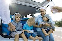 Children eating meal in back of car Stock Photo - Premium Royalty-Freenull, Code: 695-05766072